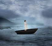 Composite image of thinking businesswoman in a sailboat on open water