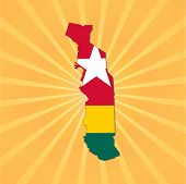 Togo map flag on sunburst illustration