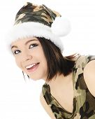 A beautiful teen girl happily looking up in her camouflage Santa hat and sleeveless shirt.  On a whi