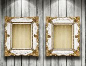 Two antique frame on wooden gallery wall