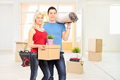 Young couple moving into a new apartment full of moving boxes