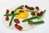 Light and tasty fried egg with asparagus and olives