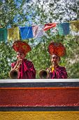 HUNDER, INDIA - SEPTEMBER 6, 2011: Tibetan Buddhist monks playing traditional musical instruments. H