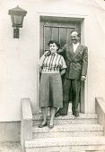 POLAND, CIRCA 1955: Vintage photo of happy couple on porch