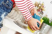 Kitchen, housework. Girl washes tea cup