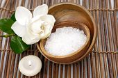 stock photo of gardenia  - gardenia with candle white salt on bowl on bamboo mat - JPG