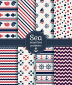 stock photo of chevron  - Set of sea and nautical seamless patterns in white pink and dark blue colors - JPG