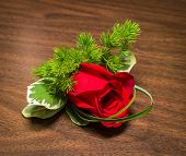 stock photo of boutonniere  - Beautiful boutonniere with rose on a table.