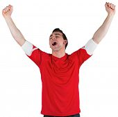 Excited football fan cheering on white background