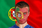 Composite image of serious young portugal fan with facepaint against digitally generated portugese n