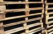 stock photo of wooden pallet  - Wooden transport pallets in stacks - JPG