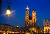 KRAKOW, POLAND - APR 7, 2014: St. Mary's Church on Rynek Glowny (Market Square) in night time. Rynek