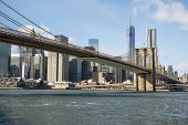 NEW YORK, US - NOVEMBER 24: Lower Manhattan skyline crossed by Brooklyn Bridge. November 24, 2013 in