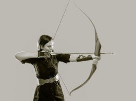 picture of fletching  - Beautiful archery woman aiming tinted black and white image - JPG