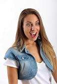 stock photo of shock awe  - Attractive young woman with a look of excited amazement surprise or awe on her face standing with an open mouth and wide eyes isolated on white - JPG