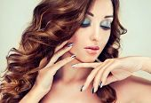 stock photo of silver-hair  - Beautiful model with long curly hair and silver nails - JPG