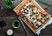 picture of chicken  - Pizza with bbq sauce chicken and bacon on a rustic table - JPG