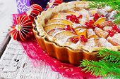 image of christmas spices  - traditional christmas apple pie and christmas decorations on festive table - JPG