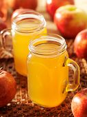 stock photo of mason  - hot apple cider in mason jars - JPG