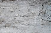 stock photo of putty  - Texture of rustic wall covered with white putty - JPG