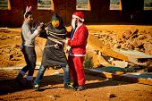pic of kidnapped  - Santa and the Easter Bunny kidnapping the Halloween monster - JPG