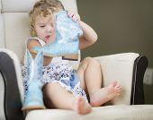 pic of baby cowboy  - Adorable Blonde Haired Blue Eyed Little Girl Putting on Cowboy Boots - JPG