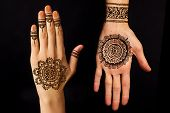 picture of mehendi  - hand with henna tattoo mehendi on black background - JPG