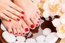 picture of pedicure  - Closeup photo of a beautiful female feet at spa salon on pedicure procedure - JPG