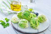 stock photo of brussels sprouts  - raw brussel sprouts on board and on a table - JPG