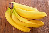 pic of bunch bananas  - fresh bananas on the wooden table - JPG