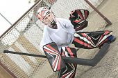 picture of hockey arena  - A young teen hockey goaler outside in the arena