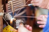 pic of transformer  - details of broken high voltage power transformer at repair shop - JPG