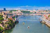 image of dom  - The Dom Luis I Bridge is a metal arch bridge that spans the Douro River between the cities of Porto and Vila Nova de Gaia Portugal - JPG