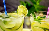 picture of refreshing  - Refreshing lemonade drink and ripe fruits against wooden background - JPG