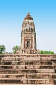 stock photo of jain  - The Khajuraho Group of Monuments are a group of Hindu and Jain temples in Madhya Pradesh India - JPG