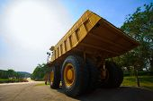 image of mines  - Heavy mining truck in mine and driving along the opencast - JPG