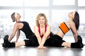 picture of do splits  - Attractive smiling mature mid age dancer female having choreography workout in group in fitness class doing splits - JPG