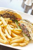 stock photo of portobello mushroom  - Portobello mushroom sandwich on a toasted ciabatta bun and side of fries  - JPG