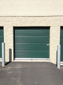 picture of self-storage  - Green self storage doors that open outside for drive up access - JPG