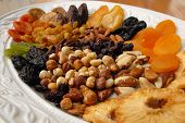 picture of fruit platter  - A selection of dried fruit and nuts on a white platter - JPG