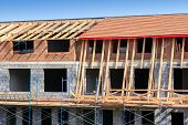 stock photo of rafters  - Roof under constructions with wooden trusses and rafters - JPG