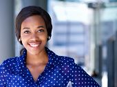 picture of single woman  - Close up portrait of a happy business woman smiling outside office building - JPG