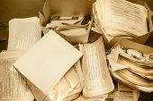 picture of messy  - Dirty messy paper documents as background closeup - JPG