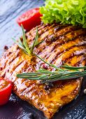 stock photo of  breasts  - Steak chicken breast olive oil cherry tomatoes pepper and rosemary herbs - JPG