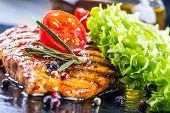 picture of fried chicken  - Steak chicken breast olive oil cherry tomatoes pepper and rosemary herbs - JPG