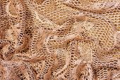 pic of rayon  - Golden Color Background Made with Folded Lacy Fabric - JPG