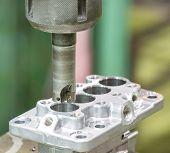 pic of machine  - operator machining aluminium automotive parts by high precision machining center - JPG