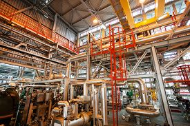 pic of pipeline  - detail of oil pipeline with valves in large oil refinery - JPG