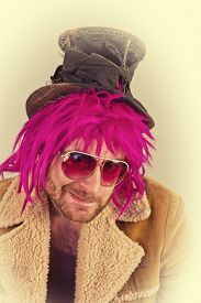 stock photo of bum  - Pink haired bearded cool bum lunatic man - JPG
