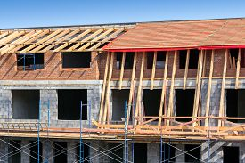 picture of rafters  - Roof under constructions with wooden trusses and rafters - JPG